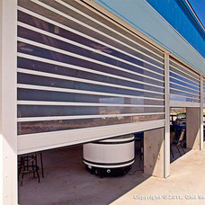Modern Exterior by Roll-a-way Storm and Security Shutters