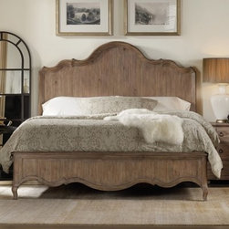 "Corsica Panel Bed - Wire Brushed Artisan - Rest easy with the elegance of the Corsica Panel Bed - Wire Brushed Artisan. This beautiful bed is constructed of acacia wood and acacia veneers with a wire brushed artisan finish in a contemporary light shade. It is available in queen size or king size, and includes the headboard, footboard, and rails with center support. Heavy molding on the headboard and footboard creates a distinctive look of traditional woodwork, with a fresh, updated finish. About Hooker Furniture CorporationFor 83 years, Hooker Furniture Corporation has produced high-quality, innovative home furnishings that seamlessly combine function and elegance. Today, Hooker is one of the nation's premier manufacturers and importers of furniture and seeks to enrich the lives of customers with beautiful, trouble-free home furnishings. The Martinsville, Virginia, based company specializes in lifestyle driven furnishings like entertainment centers, home office furniture, accent tables, and chairs.Construction of Hooker FurnitureHooker Furniture chooses solid woods and select wood veneers over wood frames to construct their high-quality pieces. By using wood veneer, pieces can be given a decorative look that can't be achieved with the use of solid wood alone. The veneers add beautiful accents of color and design to the pieces, and are placed over engineered wood product for strength. All Hooker wood veneers are made from renewable resources and are located primarily on the flat surfaces of the furniture, such as the case tops and sides.Each Hooker furniture piece is finished using up to 30 different steps, including 13 steps of hand-sanding and accenting. Physical distressing is done by hand. Pieces receive two to three coats of solid lacquer to create extra depth and add durability to the finish. Each case frame is assembled using strong mortise-and-tenon joints, which are then reinforced by mechanical fasteners and glue. On most designs, end panels extend to the floor to add strength and stability. Panel-style furniture features strong panel and frame construction to help avoid warping.Your Hooker furniture features finished case interiors to eliminate unsightly ""raw wood"" and to help protect items you may store inside drawers or cabinets. Drawer parts are given a urethane or lacquer finish to create smooth action and durability. All drawers use dovetails, either English or French, for years of problem-free use. Drawer bottoms are constructed from plywood and attached to the plywood drawer sides via the use of hot glue and/or wood glue blocks. Most drawers are full width, depth, and height to provide the maximum amount of storage space."