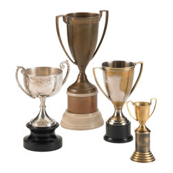 """Kathy Kuo Home - Hockday Antique Brass Nickel Decorative Trophies - Set of 4 - Bring back those memories of singing """"we are the champions"""" after the game - or just pretend you did - with this nostalgic set of trophies.  Perfect for creating a masculine, vintage effect - these four are a winning combination."""