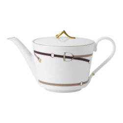 Wedgwood Equestria Teapot - Serve tea with an elegant country feel with the beautifully made Wedgwood Equestria Teapot. Crafted from fine bone china with a gold trim which brings out the warm colors of the teapot, this gorgeous teapot is dishwasher safe for your convenience. Classic stirrups in shades of tan and brown adds a rich, leather look to this teapot. A comfortable handle and gold top finish the look. About WedgwoodThrough highly skilled craftsmanship and the highest quality standards, Wedgwood manufactures quality ceramics with sophisticated, classical, and contemporary design. With a tradition of innovation, quality, and craftsmanship, Wedgwood designs are widely acknowledged as timeless, elegant, classic, and understated. Their design teams work with external designers for cross-pollination of ideas and experience. Founded in 1759 by Josiah Wedgwood, Wedgwood has been an international company determined to uphold their standards in order to maintain their leadership in the world's markets. Though their roots are over two centuries old, the company strives to stay current through partnerships with fashion designers Jasper Conran and Vera Wang with whom they've developed contemporary and stylish ranges that appeal to the younger consumers.
