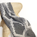 "Snakeskin Knit Throw - This modern graphic Snake Skin designed throw is knit with a blend of recycled cotton yarn and manufactured in the USA. The size is 50""x 60"" and the best part is that its machine wash & dry."