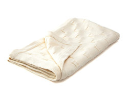 """Sefte Living - Sefte Qipi Baby Blanket Cream - You won't even need to sing """"hush little baby"""" as your precious little one basks in the sweet serenity wrapped up in this pure organic cotton blanket. Handcrafted by Peruvian artisans into a subtly woven pattern of circles nuzzled into squares, it offers an eco-friendly embrace while your infant sits (and sleeps) in the lap of luxury."""