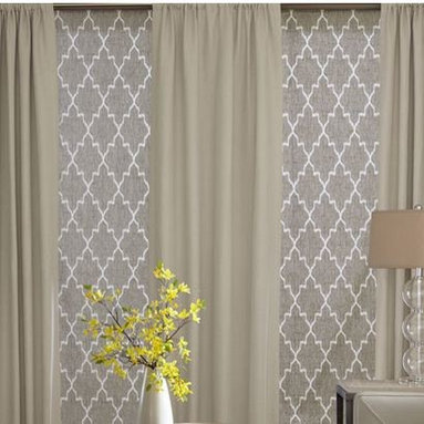 Living Room- Roman Blinds & Curtains - 3 Day Blinds Roman Shades in a geometric pattern, Andes Cement are an instant eye catcher. Layering these Shades with curtains are the perfect finishing touch to this living room.