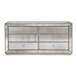 Z Gallerie - Omni Mirrored 6 Drawer Chest - Our Omni Collection demonstrates a striking use of style and restraint. While elegantly reflecting its surroundings this functional collection combines glamour with purpose. The clean lines of the cases are outlined in a hand applied silver leaf and silver beaded trim while the drawers are accented with a brushed silver hardware.