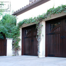 Custom Designed Wood Garage Doors & Gates in a French Mediterranean Style - Orange County, CA - Creating world-class garage doors, garden gates and shutters can only be achieved with experience, authentic design and savvy designers. Our team here at Dynamic Garage Door is a formidable selection that when combined can bring in centuries of European door manufacturing and design together in a state-of-the-art garage door, gate and shutter design company that creates some of the most gorgeous doors found in California.