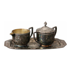 Silver Cream and Sugar Set - This gorgeous vintage WM Rogers silver set comes complete with a sugar dish, creamer and etched tray. We've left the heavy patina on the exterior of this piece-we just loved the extra character it gave! The set could be polished up to a nice bright shine if desired. Let this set sit out when not in use for a special vintage touch to any space!