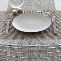 "Chilewich - Rectangle Woven Lattice Placemat - The traditional weaving pattern of the Square Woven Vinyl Placemat has been transformed into a truly modern aesthetic using a palette of contemporary neutrals. These range from natural earth tones to lustrous metallic hues. The clean pattern of this placemat creates a simple elegance . Features: -Made of vinyl.-Highly durable and maintenance free.-Overall Dimensions: 19"" W x 14"" D. Care and Maintenance: -Placemat should be stored flat to prevent permanent creasing.-Clean using soap and water with a damp cloth.-Should a stubborn stain occur, woven vinyl is very durable and can withstand aggressive scrubbing with a bleach based cleanser. This will remove the stain without altering the fabric.-Do not iron. This is a vinyl product. Order with Confidence: -Should you discover shortly after receiving your Rectangle Woven Lattice Placemat that parts are either damaged or missing, please call us immediately, and we will be happy to send you replacement parts as soon as possible and at no additional cost."