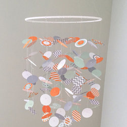 Mobiles - This unique mobile will delight your little one as they gaze as the floating dots. This mobile is handcrafted in orange, orange stripe, gray, gray chevron, mint and white. The top ring is wrapped in white cording.
