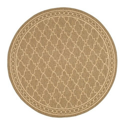 Safavieh - Round Rug in Coffee - Synthetic fiber. Machine made weave. Power loomed construction. Transitional sand colored design. Made from polypropylene. Made in Belgium. 6 ft. 7 in. Dia. Safavieh takes classic beauty outside of the home with the launch of their Collection. These rugs are suitable for anywhere inside or outside of the house. To achieve more intricate and elaborate details in the designs, Safavieh used a specially-developed sisal weave. Care Instructions: Vacuum regularly. Brushless attachment is recommended. Avoid direct and continuous exposure to sunlight. Do not pull loose ends; clip them with scissors to remove. Remove spills immediately; blot with clean cloth by pressing firmly around the spill to absorb as much as possible. For hard-to-remove stains professional rug cleaning is recommended.