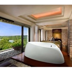 "Aquatica - Aquatica Organic Freestanding AquaStone Bathtub - No bathtub brings you closer to the feeling of bathing within a natural rock basin than the Organic freestanding bathtub. All lines of this majestic piece are smooth and elemental, suggesting rock worn smooth by rushing water, while the basin makes the bathing experience feel like surrendering to an organic hot spring. This bathtub brings the most decadent outdoor experience indoors. There is no single element of a bathroom that denotes style and elegance so succinctly as an Aquatica freestanding bathtub. Challenge the ordinary and soak in the luxury you deserve.Aquatica's bathtubs offer modern glamour at affordable prices. The Aquatica line is diverse enough to encompass both bathtubs with classical elegance that match the style of your bath and bathtub models that are distinctive and unique as the centerpiece of your remodel.FeaturesStriking upscale modern designFreestanding constructionSolid, one-piece construction for safety and durabilityExtra deep, full-body soakErgonomic design forms to the bodys shape for ultimate comfortQuick and easy installationConstructed of Hybrid Acrylic Composite - A combination of heavy gauge sanitary grade precision acrylic and synthetic stone compositeSpecial purpose heat insulating ThermoMate foam layer on the undersideDurable semi-gloss synthetic resin coating for natural stone like lookColor will not fade or lose its brilliance overtimePreinstalled cable drive pop up and waste-overflow fitting includedDesigned for one or two person bathingNon-porous semi-glossy surface for easy cleaning and sanitizingAdjustable height legsChrome plated drain10 Year Limited WarrantyCode compliant with American standard 1.5"" waste outletsAvailable in white or coffee finishSpecificationsOverall Dimensions: 87 in. L X 53.1 in. W X 28.75 in. HDepth to Overflow Drain: 14.25 in.Interior Depth: 21.25 in.Interior Length (Top): 69 in.Interior Width (Top): 39.25 in.Interior Length (Bottom): 49.25 in.Interior Width (Bottom): 22 in.Weight: 155 lbsCapacity: 63 GallonsShape: UniqueDrain Placement: ReversibleSpec Sheet White BathtubSpec Sheet Coffee BathtubNote: This model usually ships in 4-6 Weeks. Please allow an additional 2-3 business days for order transmittal and verification."