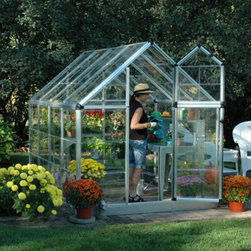 Palram - Palram Snap & Grow 6 x 8 ft. Greenhouse - HG6008 - Shop for Greenhouses from Hayneedle.com! Additional Features Gorgeous greenhouse is easy to assemble Window features weather-stripping Adjustable roof ventilation keeps plants healthy Heavy duty aluminum frame Great for growing in all climates Limited 5 year warranty Gorgeous and easy to assemble the Palram Snap & Grow 6 x 8 ft. Greenhouse is perfect for turning your backyard into a sanctuary. The crystal-clear SnapGlas panels lock into place easily and are virtually unbreakable. The preassembled split-style door provides easy access and ventilation while the window has weather stripping and the roof features an adjustable vent to help keep your plants healthy. Great for growing in all seasons you'll love having plants flowers and produce just a few feet from your own front door.