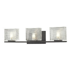 Z-Lite - Z-Lite Jaol 3 Light Vanity Light X-V3-6203 - Rectangular glass shades with horizontal textured lines soften the bright light of the Jaol vanity family. The flat arm design exudes a contemporary design finished in finely brushed nickel, rich bronze and highly polished chrome.