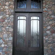 Traditional Front Doors by Elegante Iron, Inc.