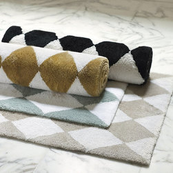 Ballard Designs - Harlequin Bath Rug - Want to introduce black and gold into a bathroom but don't want to be stuck with it forever (yes, I'm talking about black and gold plumbing fixtures)? Try starting small with these bath mats.