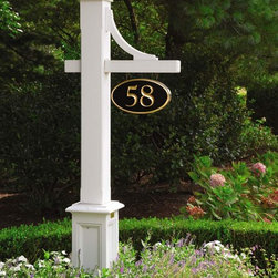 Fence and outside structures near the coast - Sign post with mortised sign arm bracket and hand carved sign