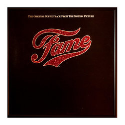 """Glittered FAME Album - Glittered record album. Album is framed in a black 12x12"""" square frame with front and back cover and clips holding the record in place on the back. Album covers are original vintage covers."""