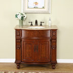 Silkroad Exclusive - 36 in. Juliana Single Sink Bathroom Vanity in - Undermount Ivory Ceramic Sink included. Travertine Stone Top included. Cabinet Finish: Natural Cherry. Hardware Finish: Antique Brass. Materials: Wood, CARB Ph2 Certified Plywood & MDF Panels, Stone, Ceramic. Distressed Finish. Pre-drilled for 3-hole, 8-inch widespread Faucet(s). Faucet(s) not included. Dimensions: 36 in. W x 22 in. D x 35 in. H (122 lbs.)Charming colonial style single sink vanity has bunt arrow feet and detail carvings along the sides. Inner frames with contrast colors and veneer finish add a contemporary touch to a traditional style.Disclaimer: Measurements are rounded off. Each of our fine bathroom vanities is a one-of-a-kind masterpiece, detailed with a multi-step hand finishing process. With individual technique and interpretation, no two pieces are exactly the same (color may vary). Individual personality of each stone top is further expressed by anomalies such as veining and coloration, as the nature of stone. Actual color may vary due to individual computer monitor display settings.