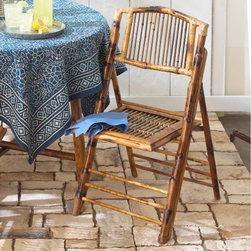 Bamboo Chairs - Set of 2 - There is no reason that folding chairs need to be ugly aluminum rentals like they store under the stage at the high school. Beautiful enough to leave out all the time, yet compact enough to fold up and store, these rattan and bamboo chairs will add eclectic charm to your home.