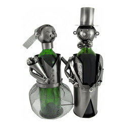 Bride and Groom Metal Sculpture Double Wine Bottle Display - This metal sculpture is a double wine bottle display- it is a wonderful addition to your home decor, and makes a cool wedding gift for a friend! It measures 13 3/4 inches tall, 10 1/2 inches long, 6 inches wide, and accommodates bottles up to 3 inches in diameter. The top pieces are attached by chains to the body of the sculpture so they can't be lost or thrown away. NOTE: All measurements include the wine bottle, but the bottle is not included with purchase.