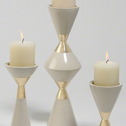GOLD & CREAM HOURGLASS PILLAR CANDLE HOLDERS - This set of cream hourglass candle holders features a striking gold band in the center that brings an elegant sculptural quality to any tabletop or display.