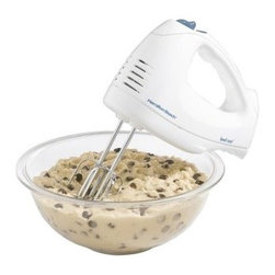 "Hamilton Beach 6 Speed Hand Mixer with Snap-On Case - White - It's time to mix things up -- and by """"things"""" we mean cookie dough, brownie mix, cake mix, and other goodies! With the Hamilton Beach 6 Speed Hand Mixer with Snap-On Case, you'll be mixing up batches of deliciousness with ease. This 250-watt mixer features six speeds and a quickburst button for extreme efficiency. For convenience, the mixer also has bowl rest feature. When you're not mixing, the mixer's cord, wire beaters, and whisk all fit in the included snap-on storage case.About Hamilton BeachOne of the country's leading distributors of small kitchen appliances, Hamilton Beach Brands, Inc. sells over 35 million appliances every year. The company's most famous brands -- Hamilton Beach, Eclectrics, Proctor Silex, and TrueAir -- are found in households across America, Canada, and Mexico. Hamilton Beach takes immense pride in their product quality, wide variety of options, superior customer service, and brand name strength and remains committed to serving customers through Good Thinking applied to the style and function in all of their small electric appliances."