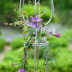 Garden Trellis Perfume - Sculptural steel garden trellis combining art and function. Original design with beautiful curved steel framework  and contemporary clean lines. A beautiful garden accent to add height and color all summer long. Each one finely handcrafted by one artisan in the USA. Photos by Bruce Buck