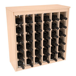 36 Bottle Deluxe Wine Rack in Pine - Great start or addition to wine rack furniture, this wooden wine rack is designed to look like a freestanding wine cabinet. Solid top and side enclosures promote the cool and dark storage area necessary for aging your wine properly. Your satisfaction and our racks are guaranteed.