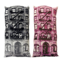 "PG Brick Pillow - The design company that produces these pillows is called ""Build Your Block,"" and you literally can do just that. Taking old New York tenements and printing them in pink on a sofa pillow definitely takes the grit and bad memories of old industrial New York and replaces them with nostalgia and warm memories of the old city."