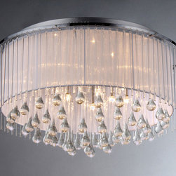 Warehouse of Tiffany - Demeter Chrome 8-light Chandelier - Add some elegance to your home with this Demeter Chrome Chandelier. This dynamic lighting element features generous rows of cascading crystals to catch the light.