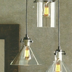Clear Glass Collection Bronze 1 Light Pendant - Bronze frames support clear glass cylinders or cones in these simple, architectural lamps. Created with Roost's Filament Bulbs in mind, these lamps look best when framing their soft light.