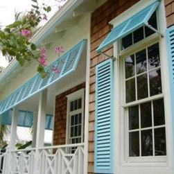 Architectural Design Shutters - Samples of Arhitectural Design Shutters work - Bahama shutters with colonial shutter panels. Save money through direct manufacturer, including measure and install. Call Greg Gardella at 239 330 5211 for a quote for your custom needs.