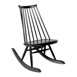 Artek - Mademoiselle Rocking Chair by Artek - Designed by Ilmari Tapiovaara, who was known for capturing the essence of the Finnish identity, the Artek Mademoiselle Rocking Chair slopes ever so gently backward as if welcoming one to rest and relax within its birch wood body. First introduced in 1956, the Mademoiselle is offered here in Black stain or White.Founded in Finland in 1935 by four self-proclaimed idealists, Artek stands strong on the company's ethics, product aesthetics and ecology. With products that offer the Scandinavian look--clean lines, minimal fluff--Artek has built a line that incorporates a modern, approachable appeal into modern furniture and lighting design.The Artek Mademoiselle Rocking Chair is available with the following:Details:Made of birch woodMade in FinlandDesigned by Ilmari Tapiovaara, 1956Options:Color: Black Stained, or White Painted.Shipping:Black Stained usually ships in 10 business days; White Painted usually ships in 12-14 weeks.