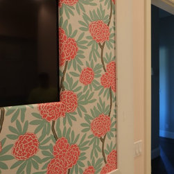 """In-Mirror TVs - A 40"""" TV flows seamlessly into a fabric wrapped cork bulletin board."""