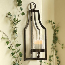 Laurent Floor Lantern and Wall Sconce - I love this lantern. The iron already looks like it has a patina to it. I also love the versatility. It has feet for table placement, wall hanging or can be a floor lantern as well. The design reminds me of a paper cutout pattern repeating itself.
