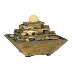 "Lamps Plus - Four Tiers Feng Shui Copper and Slate Table Fountain - Make your living spaces come alive with this soothing tabletop water fountain. Water falls from level to level spilling over pebbles as it goes. Natural slate construction. decorative rocks included. Pump included. 12"" wide. 9"" high. 12"" deep.  Floor fountain.  Natural slate construction.  Pump included.  Decorative rocks included  12"" wide.  9"" high.  12"" deep."