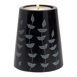 Sitara Collections - Hand-Carved Cone Shaped Palewa Soapstone Tea Light Holder - Black soapstome Sets the Stage for this Unique, Come-Shaped Tea Light Holder. the Design is Lightened by Leafy Branches Reaching Up toward the Flame, adding a Nature-infused Element That Takes It From Serious to Seriously Charming. the Hand-Carved Holder Measures 3.2 inches X 2.55 inches Makes a Great Hose-Warming Gift Setting: indoors Type: ome (1) Tea Light Candle Holder Colors: Grey with White accents ome Tea Light included (Unscented) Materials: soapstome Dimensioms: 3.2 inches High X 2.6 inches Diameter.