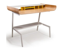Offi Half Pipe Desk in Oak - The Half Pipe Desk by Offi & Company is a stylish and minimal desk for the office or home. Made of molded plywood with a choice of three veneers, and powder-coated metal legs, the Half Pipe Desk is both practical and durable. Available in Walnut, Oak or Birch Veneer. An Eric Pfeiffer design.