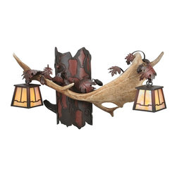 Meyda - Meyda Tiffany Antlers Fallow Deer Two-Light Wall Sconce - Meyda Tiffany was founded when Meyer Cohen was asked by his wife Ida (whose names were combined into the company name Meyda) to build a stained glass window in their kitchen so they wouldn't have to look at the vintage cars in their neighbor's driveway. What began as a hobby evolved into America's leading and oldest manufacturer of custom and decorative lighting. Today Meyda is still a family-run business with the Cohens' son Robert at the helm. Features include Theme: Rustic Lodge Family: Antlers Fallow Deer Every Meyda Tiffany item is a unique handcrafted work of art. Natural variations in the wide array of materials that they use to create each Meyda product make every item a masterpiece of its own. Photographs are a general representation of the product. Colors and designs will vary.. Specifications Number Of Bulbs: 2 Bulb Wattage: 60 Bulb Type: Halogen.