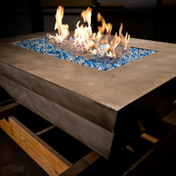 Concrete Fire Table - Concrete fire table that can be set up for propane or natural gas.  There is room for a 25 gal propane tank under fire burner.  Glass comes in a wider arrange of colors. Comes in two pieces movable by to men. The table is 4'x6' and the burner is 2'x4'.