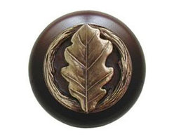 """Notting Hill - Notting Hill Oak Leaf/Dark Walnut Wood Knob - Antique Brass - Notting Hill Decorative Hardware creates distinctive, high-end decorative cabinet hardware. Our cabinet knobs and handles are hand-cast of solid fine pewter and bronze with a variety of finishes. Notting Hill's decorative kitchen hardware features classic designs with exceptional detail and craftsmanship. Our collections offer decorative knobs, pulls, bin pulls, hinge plates, cabinet backplates, and appliance pulls. Dimensions: 1-1/2"""" diameter"""