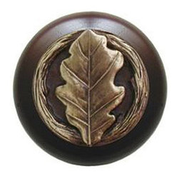 "Notting Hill - Notting Hill Oak Leaf/Dark Walnut Wood Knob - Antique Brass - Notting Hill Decorative Hardware creates distinctive, high-end decorative cabinet hardware. Our cabinet knobs and handles are hand-cast of solid fine pewter and bronze with a variety of finishes. Notting Hill's decorative kitchen hardware features classic designs with exceptional detail and craftsmanship. Our collections offer decorative knobs, pulls, bin pulls, hinge plates, cabinet backplates, and appliance pulls. Dimensions: 1-1/2"" diameter"
