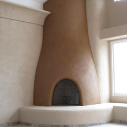 """American Clay Earth Plaster - The walls around this kiva fireplace are plastered in American Clay Plaster """"Nantucket Sand."""" The kiva is plastered with a clay plaster made from the deep red, clay-rich soil from the property. Photo: Simple Constuct"""