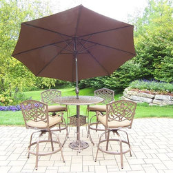 Oakland Living - 7-Pc Patio Bar Set in Antique Bronze Finish - Includes a bar table, four swivel bar stools with cushions, 108 in. tilt crank umbrella with stand and metal hardware. Traditional lattice pattern and scroll work. Handcasted and lightweight. Durable and rust free. Fade, chip and crack resistant. Hardened powder coat. Warranty: One year. Made from cast aluminum. Minimal assembly required. Table: 42 in. Dia. x 44 in. H (60 lbs.). Bar stool: 29 in. Dia. x 45.75 in. HThe Oakland Mississippi Collection combines grace style and modern designs giving you a rich addition to any outdoor setting. The pattern is crisp and stylish. Each piece is finished for the highest quality possible. This set will be a beautiful addition to your patio, balcony or outdoor entertainment area. Our bar sets are perfect for any small space, or to accent a larger space. We recommend that the products be covered to protect them when not in use. To preserve the beauty and finish of the metal products, we recommend applying an epoxy clear coat once a year. However, because of the nature of iron it will eventually rust when exposed to the elements.