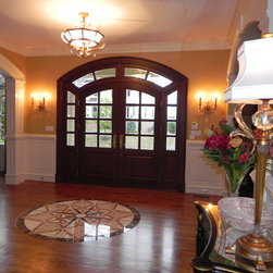 Arched Double door with sidelights and transom. -