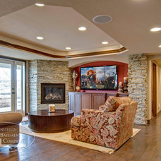 Traditional Family Room by Finished Basement Company