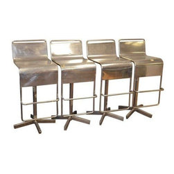 Pre-owned  Mid-Century Stainless Steel Bar Stools - Set of 4 - We love these sleek, industrial chic stools. Stainless steel bar stool with sleek s-curve seat and foot rest. Seat swivels in full circle and stands sturdy on solid, weighted base with holes pre-drilled for mounting to floor. Functions freestanding or floor mounted. Epitomizes mid-century design at its finest: sophisticated, stream-lined functionality in stainless. Sold as set of four.