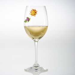 Frontgate - Set of 12 Sunny Day Wine Charms - Keeps glasses from being mixed up. Magnetic charms attach to glass bowl of stemmed and stemless glasses. Also works on martini, pilsner, and pint glasses – and any type of glass up to approximately 5mm thick. Magnetic charms fit on stemless glasses; traditional charms don't. Remove charms from glasses before washing. Add personality to any glass while keeping each drink unique with our Sunny Day Wine Charms. Colorful magnets attach to the bowl of your glass. This set of 12 includes a vibrant variety of beach designs.  .  . Also works on martini, pilsner, and pint glasses - and any type of glass up to approximately 5mm thick . Magnetic charms fit on stemless glasses; traditional charms don't .  . Wipe clean with a damp cloth . Please note: This is not a toy.