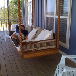 Hanging day bed made from antique shutters - One of our hanging day beds finds a wonderful home!  Custom designed from antique shutters and reclaimed cypress.