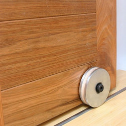 Barn Door Hardware Bottom Roller - Our exclusive Modern Style Barn Door Hardware system will fit any of your rolling door hardware needs. This is a contemporary , yet rustic style of barn door hardware. Comes with a lifetime warranty, this modern barn door hardware is made to last.