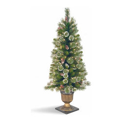 4 Ft. Glittery Pine Entrance Christmas Tree w/ 100 Clear Lights - Measures 4 feet tall with 22 inch diameter. Indoor or outdoor use. Pre-lit with 100 UL listed, pre-strung Clear lights. Decorative urn base. Tip count: 109. Light string features BULB-LOCK to keep bulbs from falling out. Fire-resistant and non-allergenic. Packed in reusable storage carton.